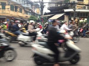 Blurry streets of Hanoi, as motor bikes rush by