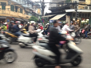 Blurry streets of Hanoi, as motor bikes rush by